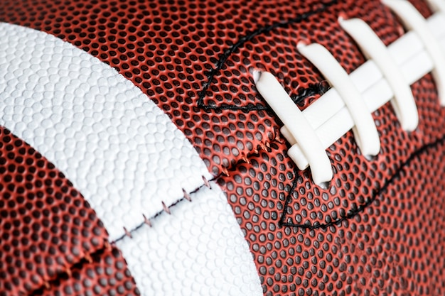 アメリカンフットボールのボールの背景のマクロショット