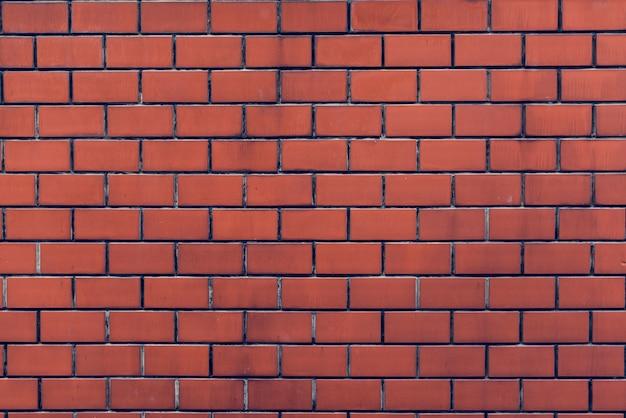レンガの壁のオレンジ壁紙のパター