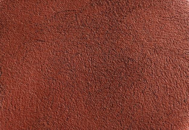 暗い赤のペイントの壁の背景のテクスチャ