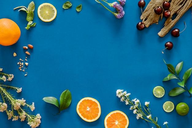 熱帯の柑橘類の背景の盛り合わせ