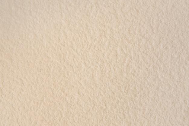 空白ベージュのテクスチャ壁紙の背景