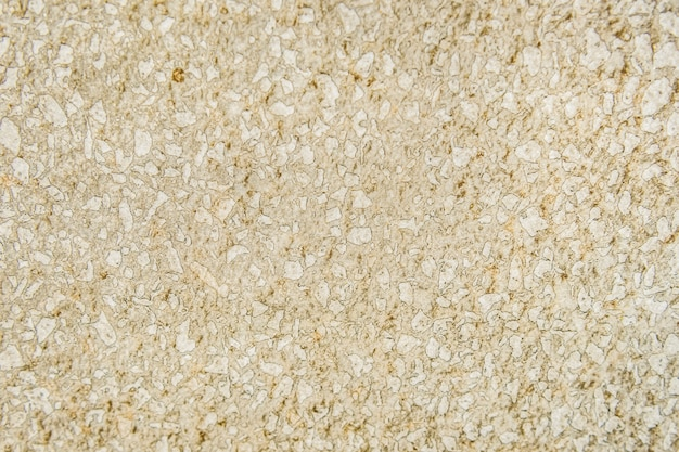 Текстурированная стена из бежевого мрамора