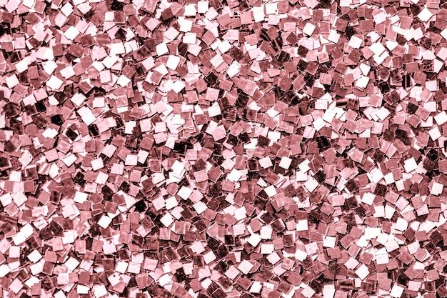 ピンクのスパンコールの背景のクローズアップ