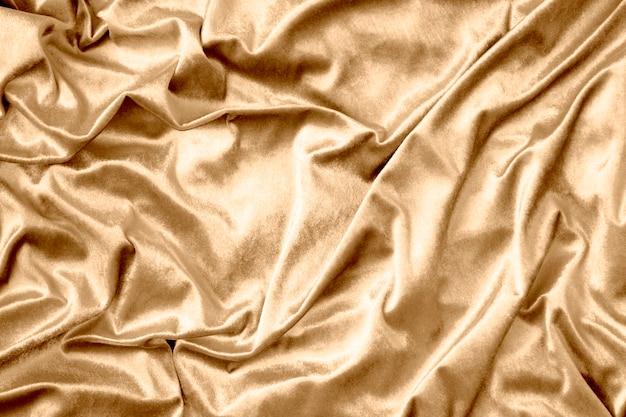 黄金の光沢のあるシルクの生地の質感