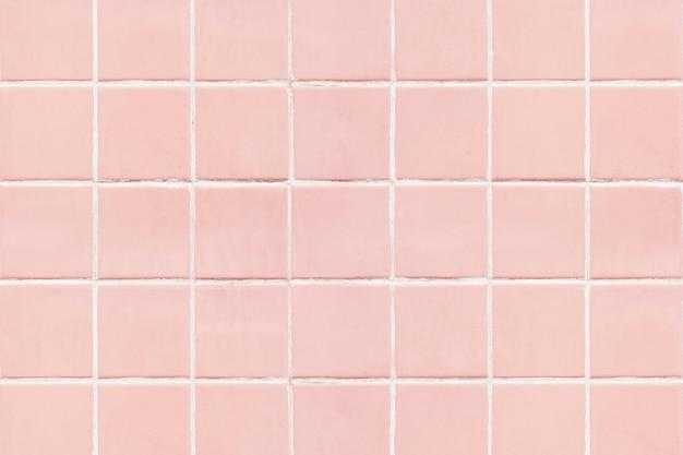 ピンクの正方形のタイルテクスチャの背景