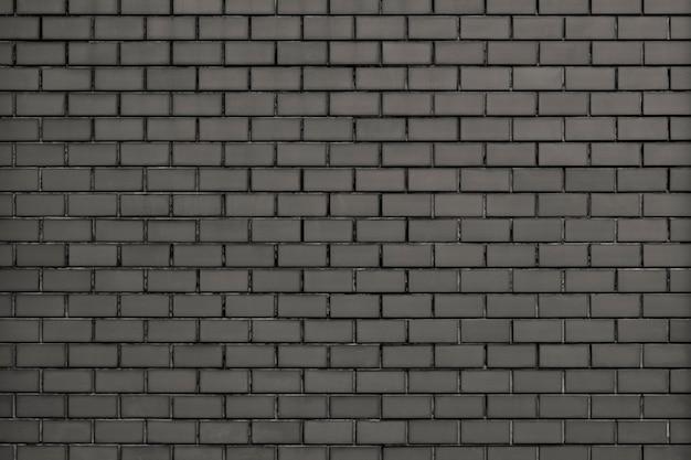 灰色の現代のレンガの壁のテクスチャ背景