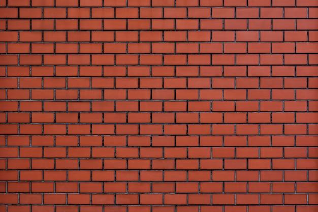 オレンジ色のレンガの壁のテクスチャ背景