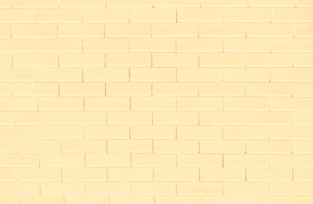黄色のレンガの壁のテクスチャ背景