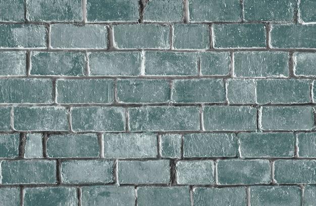 緑の質感のレンガの壁の背景