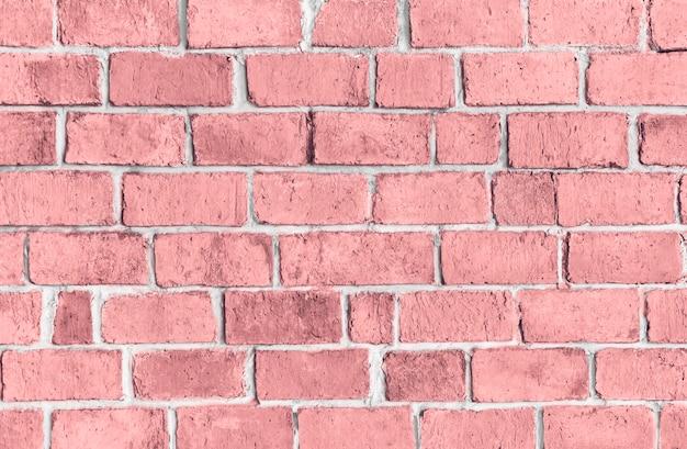 ピンクの質感のレンガの壁の背景