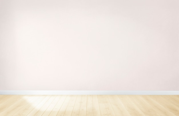 木製の床と空の部屋で光のピンクの壁