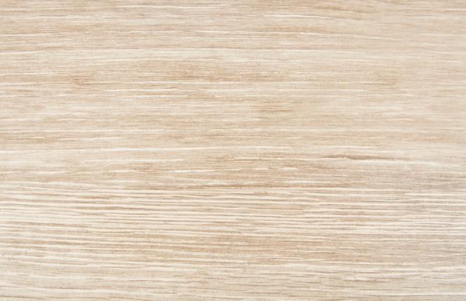 ライトブラウンの木製の織り目加工の背景