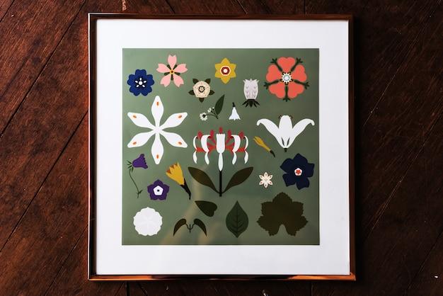 画像行くフレームの花のコレクションを描く手