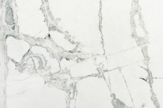 白い大理石の織り目加工の壁のクローズアップ