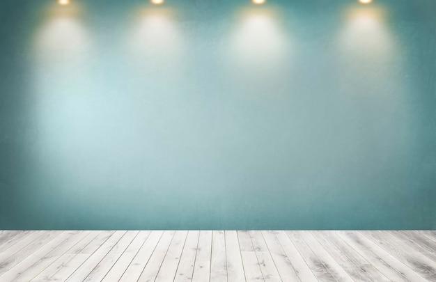 空の部屋でスポットライトの行と緑の壁