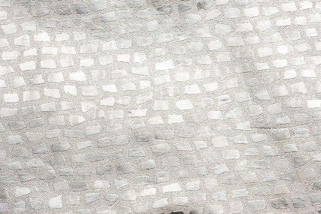 Блестящий серебряный узорчатый фон ткани