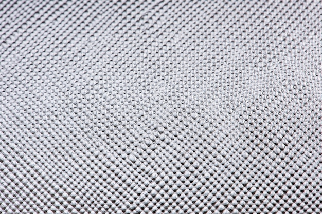 光沢のあるシルバーの質感のある紙の背景