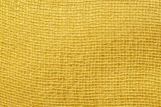 光沢のある金色の表面テクスチャ背景