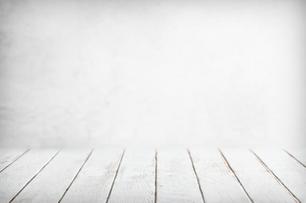 白い木製のテーブルの背景