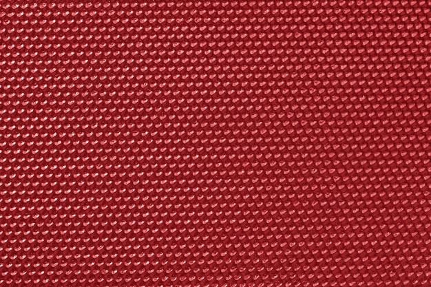 Обои красного цвета в виде сот