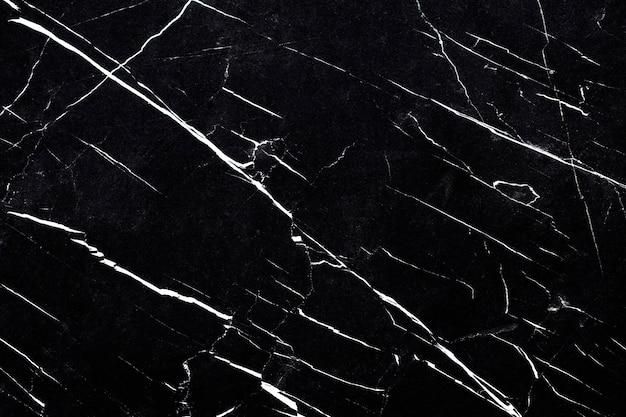黒と白の大理石の織り目加工の壁のクローズアップ