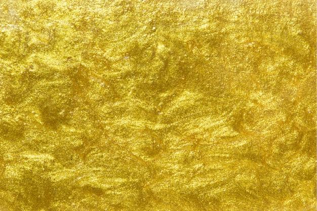 ゴールド塗装の質感のある壁の背景