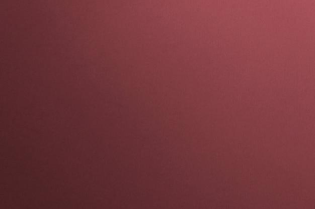 赤いコンクリートの質感のある壁