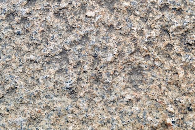 大まかな茶色の石の背景の水平方向のテクスチャ