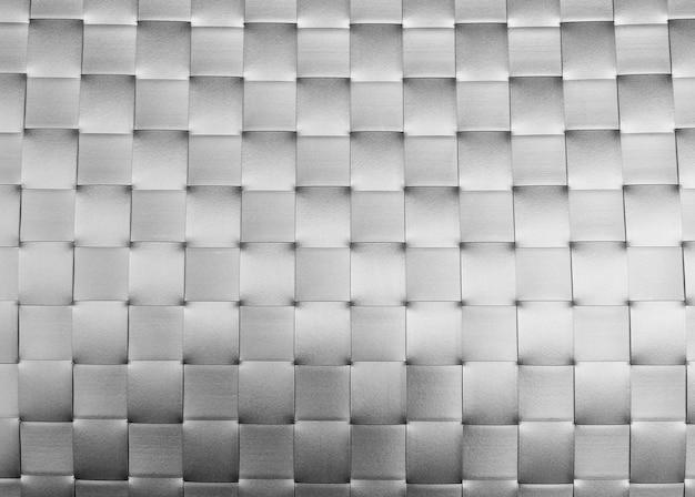 銀のプラスチック製の織りパターンのクローズアップ