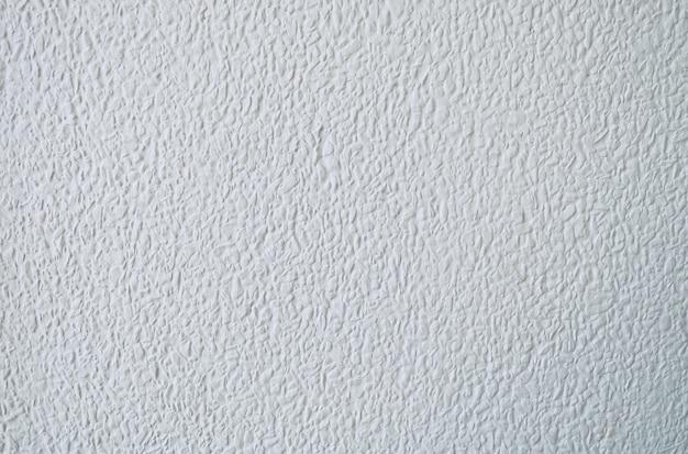 白い漆喰壁の背景のテクスチャ