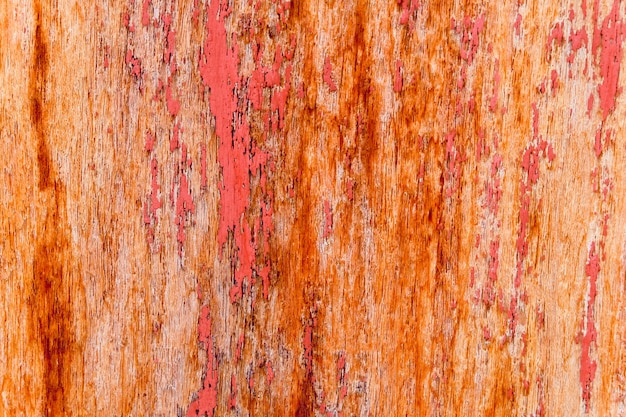 ぼろぼろのウッドの背景の古い赤のテクスチャ