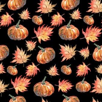 秋の紅葉と黒の背景にカボチャの水彩ハロウィーンパターン
