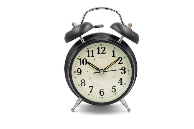 白い背景に分離されたヴィンテージ黒目覚まし時計