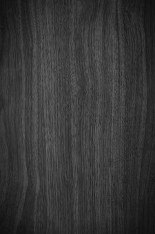 ヴィンテージスタイルでグランジテクスチャと素朴な暗い木のテーブルの表面を閉じます