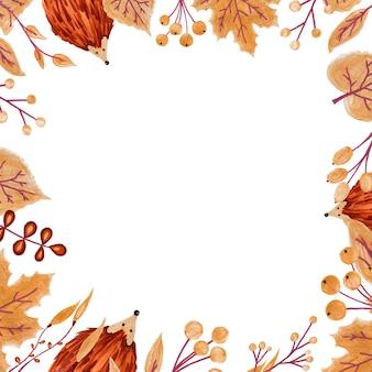白い背景の上の葉とハリネズミで作られた正方形のフレーム。