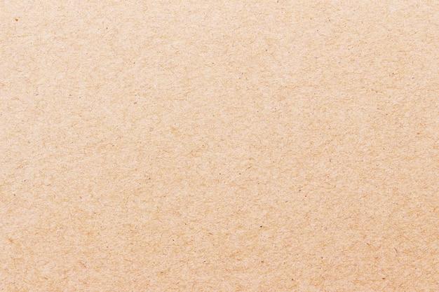 Конец вверх коричневой текстуры бумаги ремесла для предпосылки