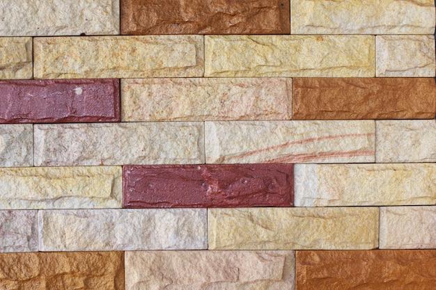 背景の砂岩の壁のテクスチャの美しい