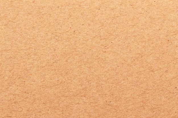 背景の茶色のクラフトペーパーテクスチャのクローズアップ