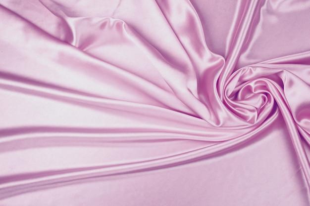 Фиолетовая роскошная атласная текстура ткани для фона