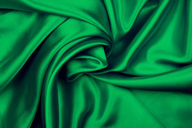滑らかでエレガントなグリーンシルクまたはサテンの質感
