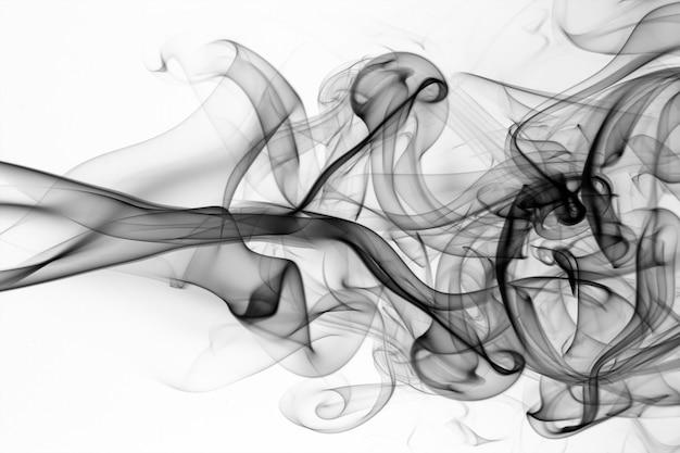 黒い煙の抽象的な白い背景、火のデザイン、有毒物質の移動