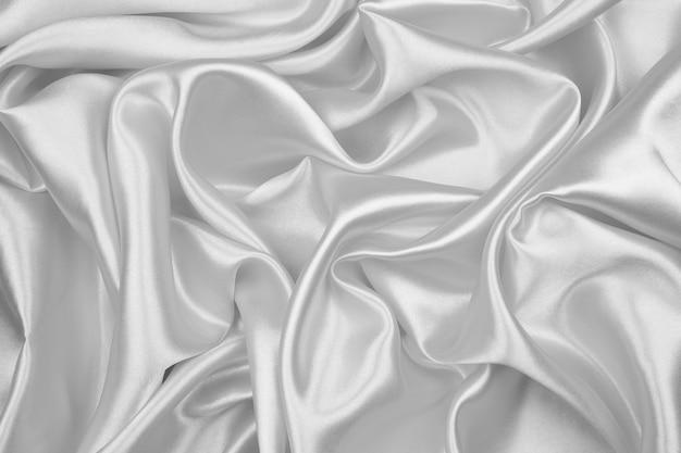 黒と白の絹の質感の抽象的な背景の豪華なサテン