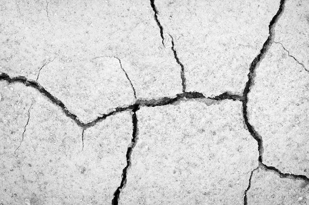 土壌干ばつひび割れテクスチャ背景、黒と白