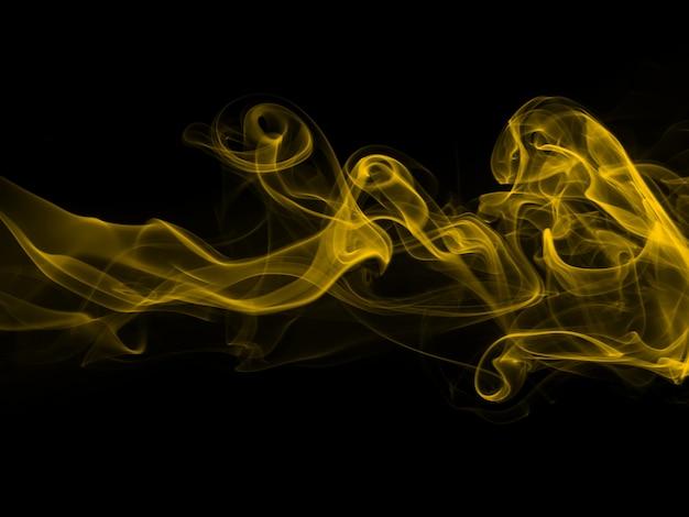 黒の背景に抽象的な黄色い煙。火のデザイン