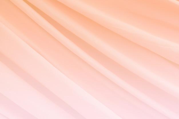 ピンク色のシルクの質感の抽象的な背景の豪華なサテン
