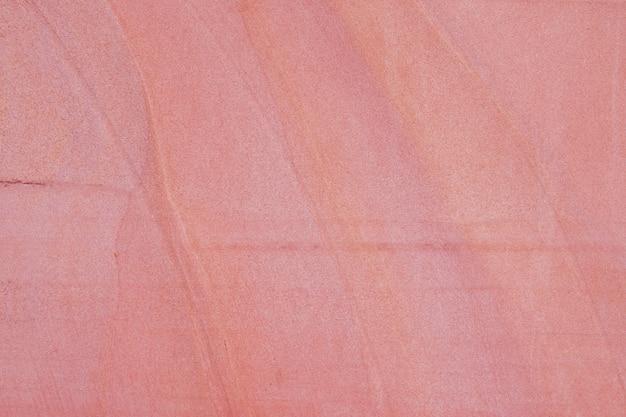 Красная предпосылка текстуры каменной стены песка. абстрактный каменный пол