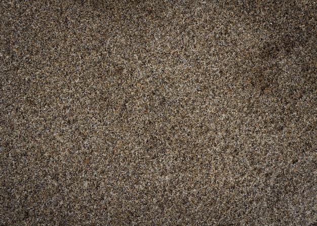 濡れた砂の自然テクスチャ背景。上面図