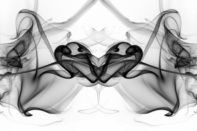 白い背景の美しい黒い煙抽象火災