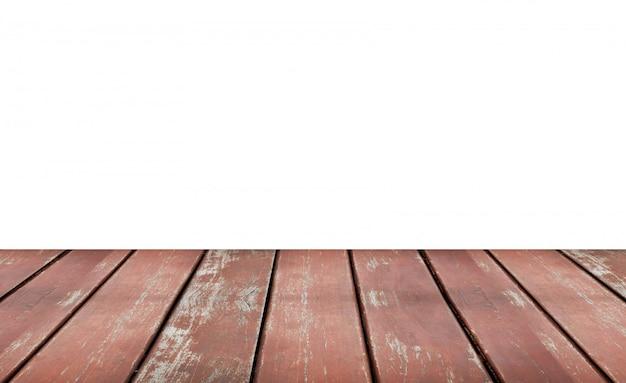 白い背景に分離された空の茶色の古い木製の棚。製品のモンタージュ