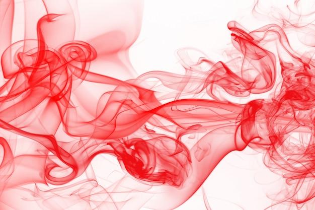 白い背景に、インクの水の色に赤い煙抽象
